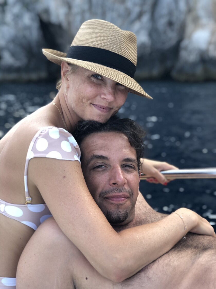 A close-up photo of a couple on a boat