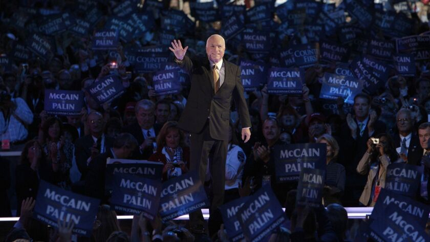 Republican presidential candidate John McCain acknowledges the crowed as he goes on stage at the Republican National Convention in St. Paul, Minn., in 2008.