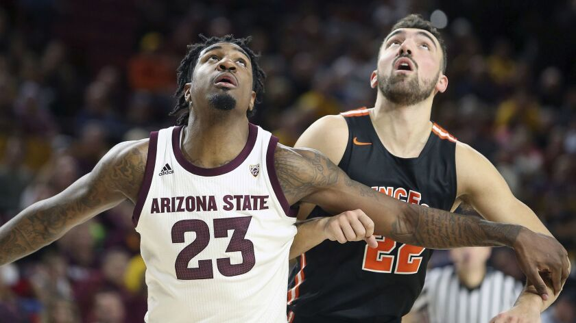 Arizona State and Princeton players battle for position under the basket during the first half of an NCAA college basketball game on Dec. 29, 2018, in Tempe, Ariz.