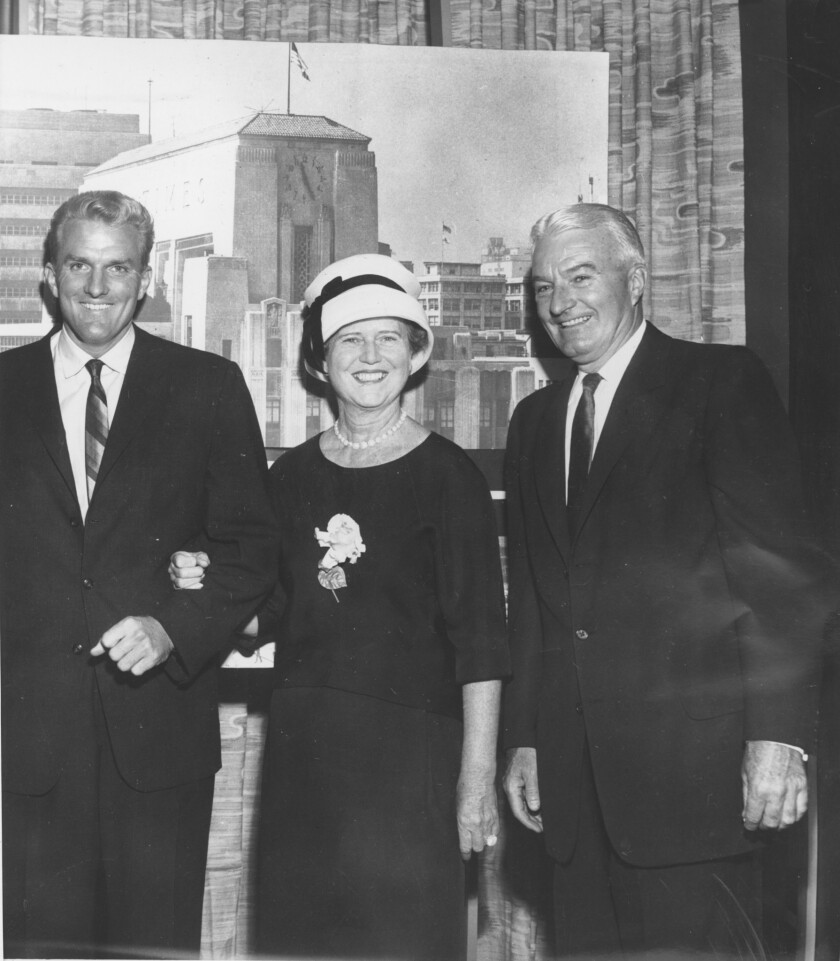 Dorothy Chandler and Norman Chandler, right, with son Otis when he was named Times publisher in 1960.