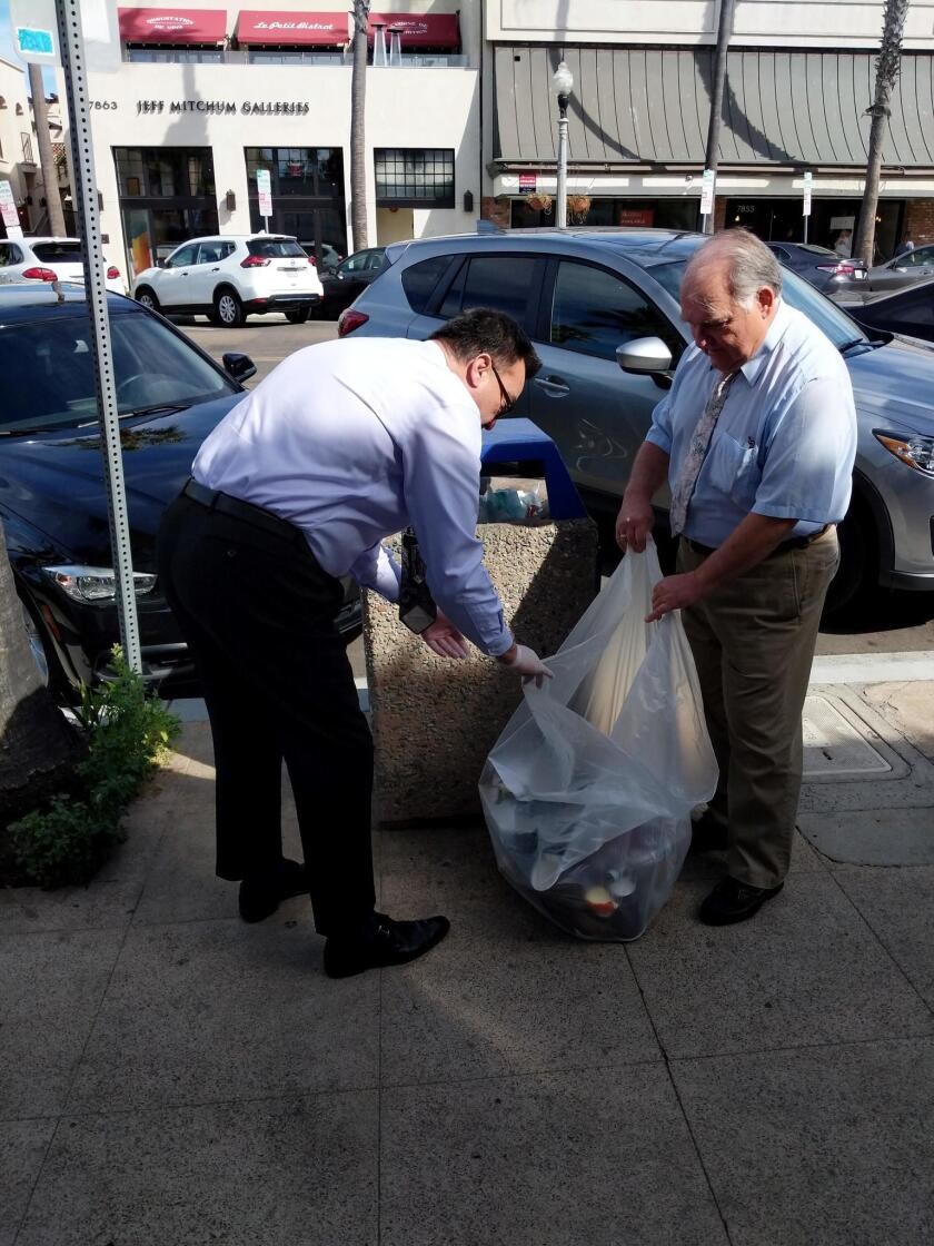 Photograph taken at 1:20 p.m. Saturday, Feb. 17 on Girard Avenue, as some merchants are resorting to taking matters into their own hands, since the City of San Diego will not empty over-flowing, public trash bins in La Jolla until after a holiday weekend. — Submitted by Gerhard Bendl