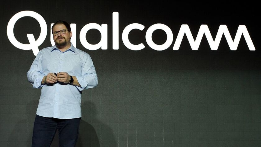 Qualcomm, led by Cristiano Amon, will supply chips and license its technology to Apple and will receive royalty payments, the companies said.