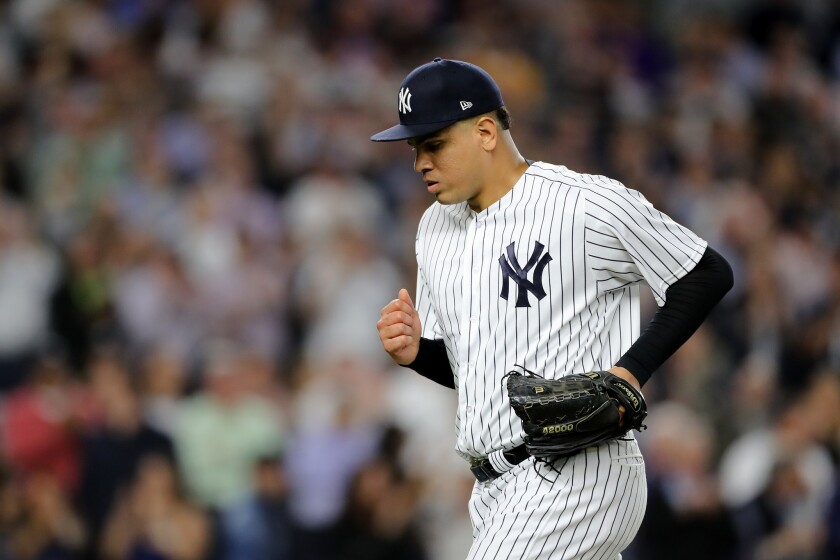 """Dellin Betances #68 of the New York Yankees was one of several players to walk with their suitcases past striking workers chanting """"don't check in, check out."""""""