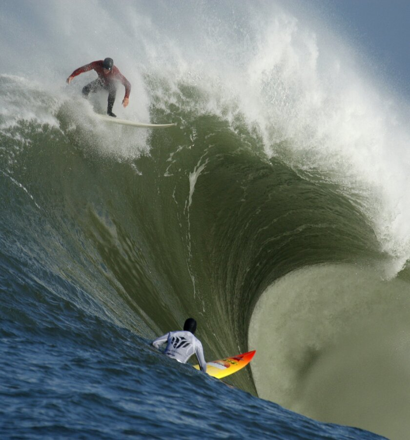 "FILE - In this Feb. 13, 2010, file photo, Evan Slater, top, surfs a giant wave over Darryl ""Flea"" Virostko during the first heat of the Mavericks surf contest in Half Moon Bay, Calif. The world's best big-wave competition, Titans of Mavericks has been set for Friday, Feb. 12, 2016. Mavericks is the"