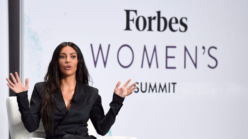 Kim Kardashian speaks on stage with Steve Forbes at the 2017 Forbes Women's Summit at Spring Studios