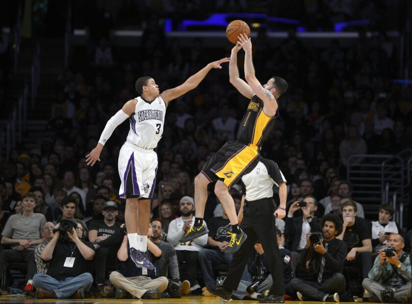 Los Angeles Lakers guard Jordan Farmar, right, puts up a shot as Sacramento Kings guard Ray McCallum defends during the second half of an NBA basketball game, Friday, Feb. 28, 2014, in Los Angeles. (AP Photo/Mark J. Terrill)