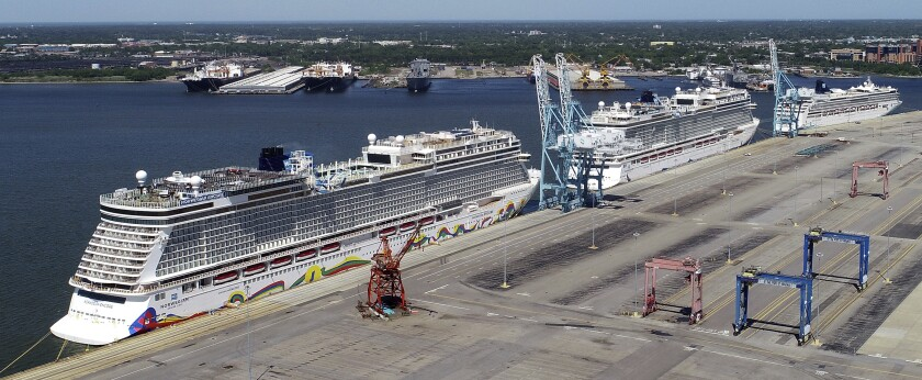 FILE - In this May 4, 2020 file photo, Norwegian cruise ships are docked at Portsmouth Marine Terminal in Portsmouth, Va. Norwegian Cruise Line asked a federal judge Friday, Aug. 6, 2021, to block a Florida law prohibiting cruise companies from demanding that passengers show written proof of coronavirus vaccination before they board a ship. (Stephen M. Katz/The Virginian-Pilot via AP, File)