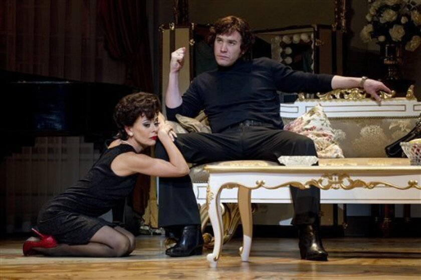"""In this undated theater image released by The O & M Company, Tracie Bennett, left, and Tom Pelphrey are shown in a scene from """"End of the Rainbow,"""" in New York. (AP Photo/The O & M Company, Carol Rosegg)"""