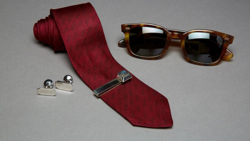 Kennedy's cufflinks, tie, tie bar and Polaroid sunglasses on display at the JFK Library & Museum in