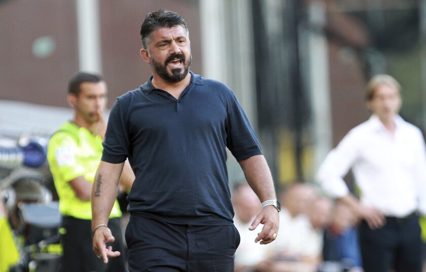 Napoli coach Gennaro Gattuso makes remarks on the sidelines during a Serie A soccer match against Genoa at the Luigi Ferraris Stadium in Genoa, Italy, Wednesday, July 8, 2020. (Tano Pecoraro/LaPresse via AP)