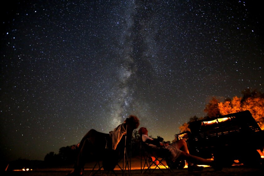 Sue and John Schafer wait for the Perseid meteor shower to unfold from Anzo-Borrego Desert State Park in 2013.