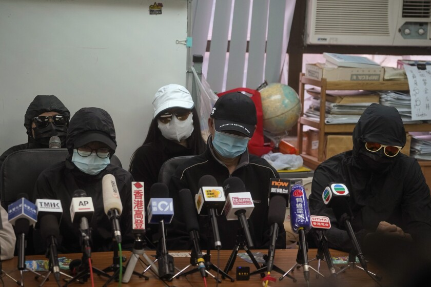 Relatives of a dozen Hong Kong residents who have been detained in mainland China attend a press conference in Hong Kong, Saturday, Dec. 12, 2020. The relatives made a plea Saturday to be informed of the timing of any trials and whether they could attend. (AP Photo/Kin Cheung)