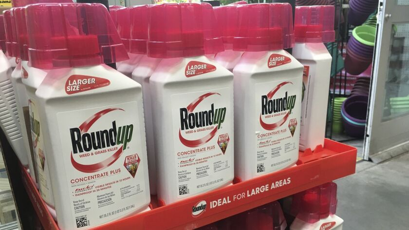 In this Sunday, Feb. 24, 2019 photo, containers of Roundup are displayed at a store in San Francisco