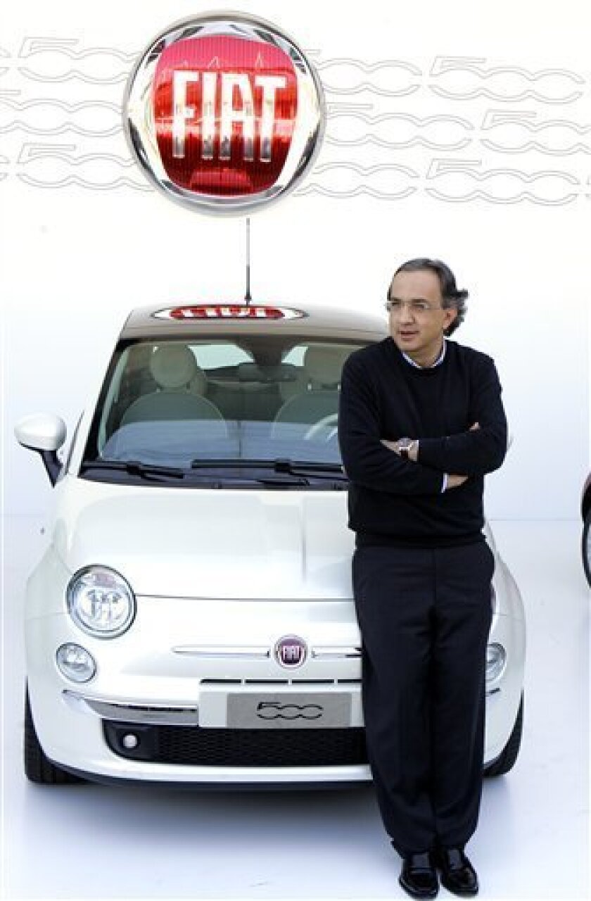 Fiat CEO Sergio Marchionne poses near the new Fiat 500, during the official presentation in Turin, Italy, in this Thursday, July 5, 2007 file photo. Fiat and Chrysler said Tuesday, Jan. 20, 2009  they have agreed to form a strategic alliance that would give the Italian auto empire a 35-percent sta