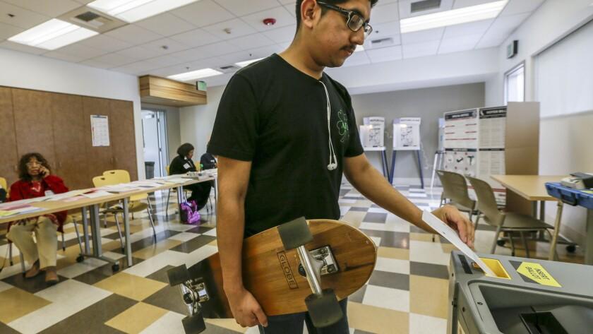 First-time voter Saul Daniel Diaz votes at Douglas F. Dollarhide Community Center in Compton.