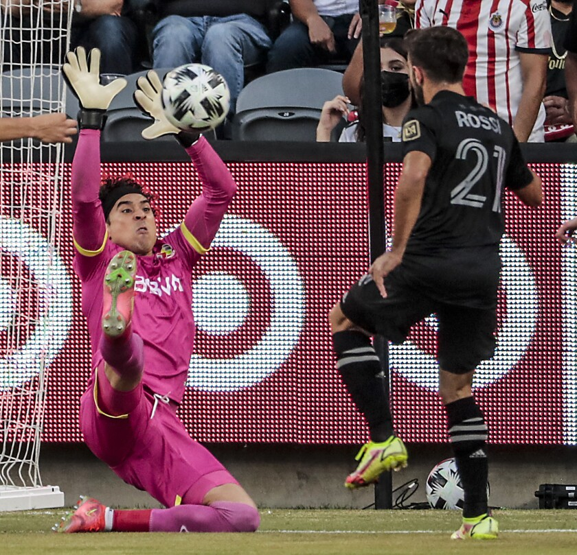 MLS forward Diego Rossi tries to score on Liga MX goalkeeper Guillermo Ochoa