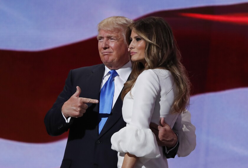 Donald Trump stands with his wife, Melania, after her prime-time speech Monday night at the Republican National Convention in Cleveland.