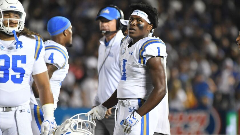 PASADENA, CALIFORNIA SEPTEMBER 30, 2017-UCLA defensive back Darnay Holmes watches a replay as he is