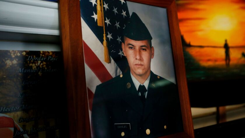 In his office, Hector Barajas keeps a photo of himself in his U.S. Army uniform at age 18.