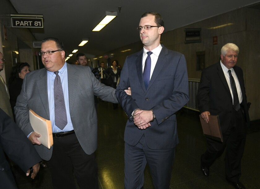 (Center) Etienne Uzac arrives for his arraignment at Manhattan Supreme Court on Thursday to answer fraud charges brought against him.