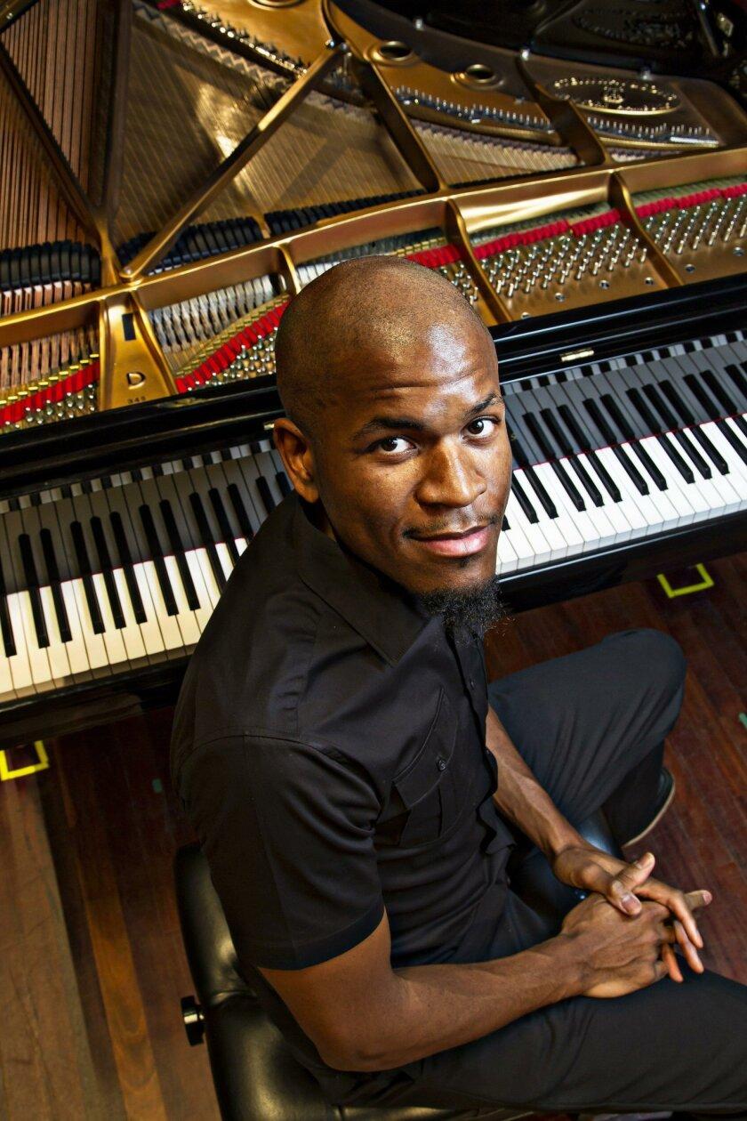 SAN DIEGO, CA January 8, 2016 : | Jazz pianist Joshua White sits on stage at Joan and Irwin Jacobs Music Center , Copley Symphony Hall on Friday in San Diego, California. | (Eduardo Contreras / San Diego Union-Tribune)