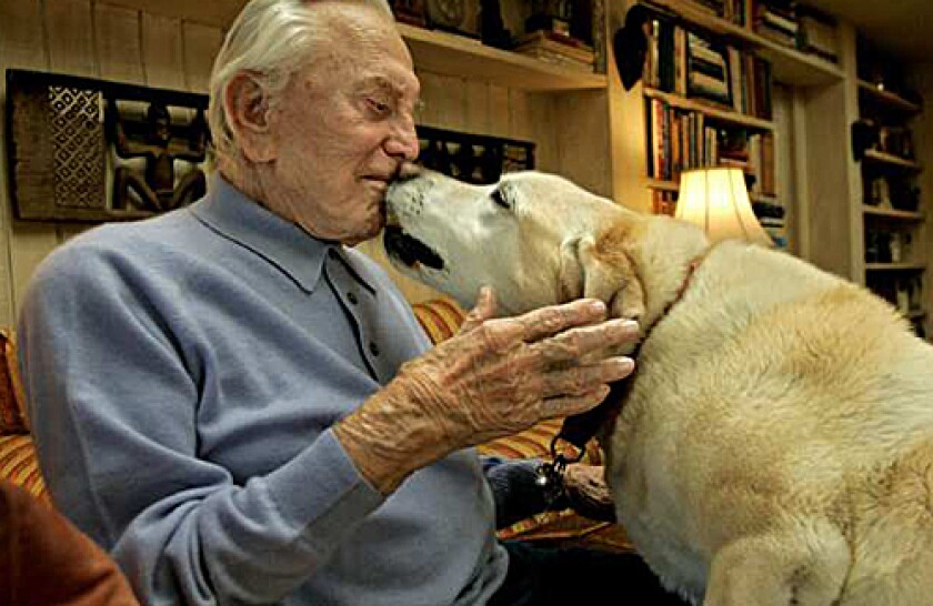 SHOWING THE LOVE: Kirk Douglas and his 9-year-old lab, Danny.