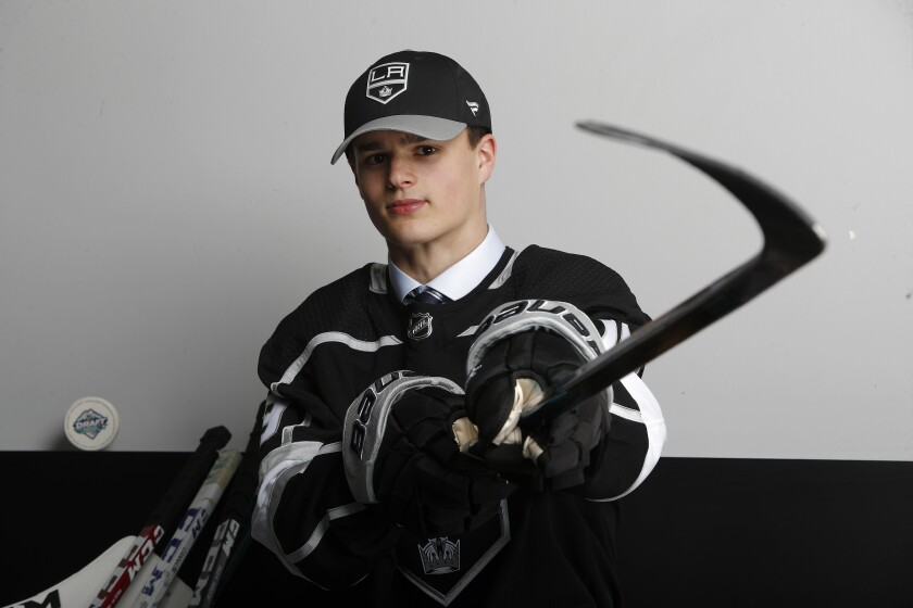 Alex Turcotte poses for a portrait after being selected fifth overall by the Kings in the 2019 NHL draft.
