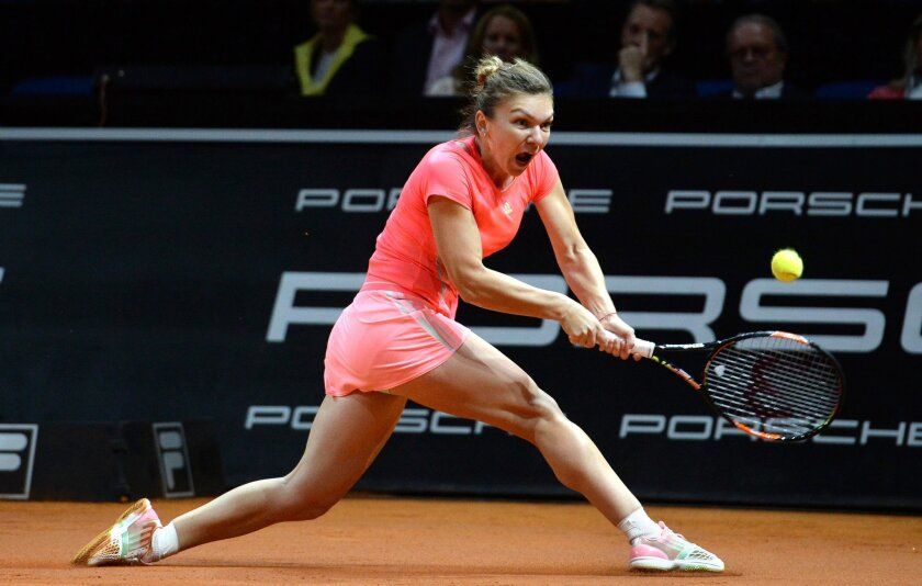 Romania's Simona Halep returns the ball to Italy's Sara Errani during their quarterfinal match at the Porsche Grand Prix tennis tournament in Stuttgart, Germany, Friday, April 24, 2015. (Marijan Murat/dpa via AP)