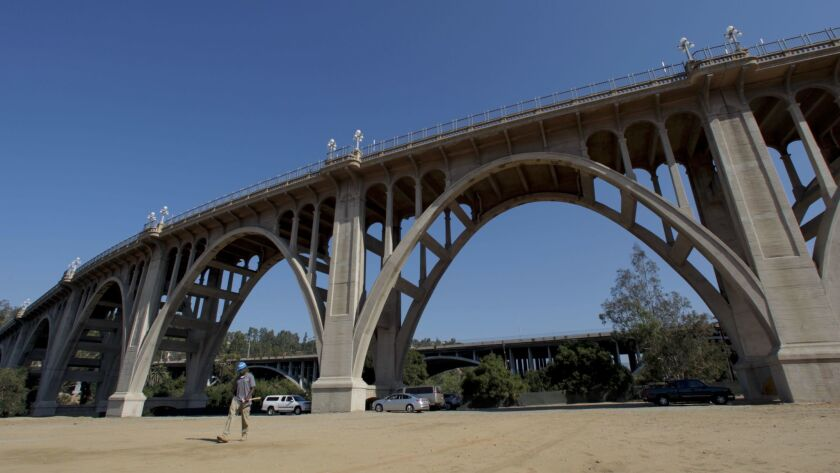 Pasadena bridge. Pasadena city crews are erecting higher fences on the Colorado Street bridge to pre