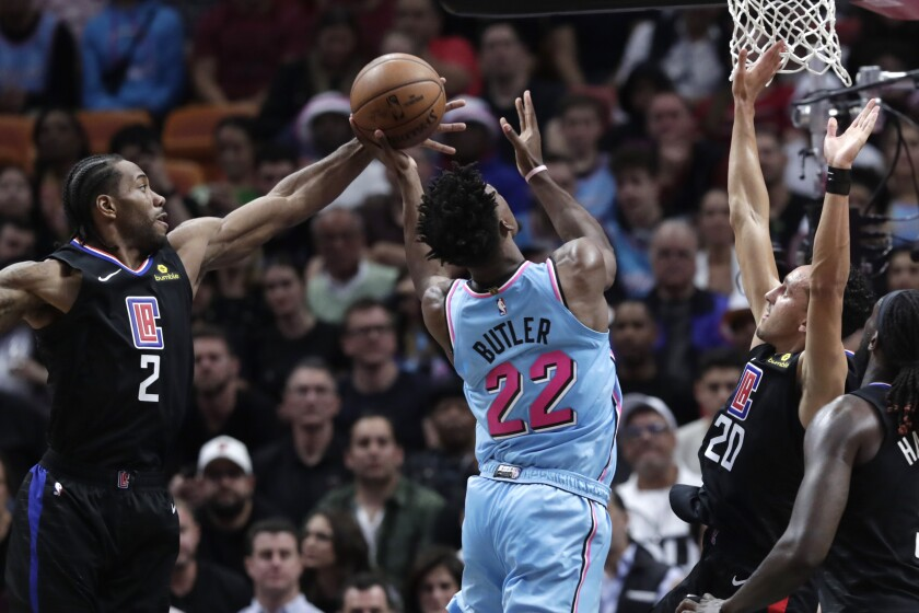 The Clippers' Kawhi Leonard, left, and Landry Shamet, right, defend the Heat's Jimmy Butler on Jan. 24, 2020, at AmericanAirlines Arena.