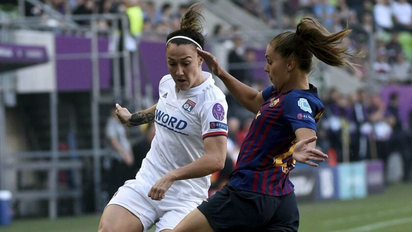 Lucy Bronze of Lyon, left, in action against Lieke Martens of Barcelona during the women's soccer UE