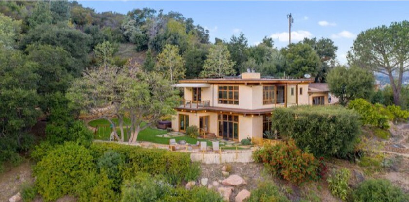 Perched on three acres, the scenic estate holds a two-story home surround by hiking trails, fruit trees and lookout spots.