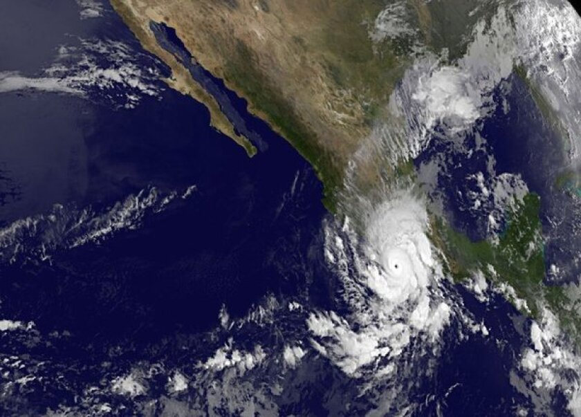 A satellite image shows Hurricane Raymond off Mexico's Pacific Coast.