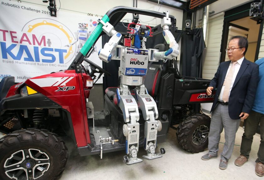 Increasingly computerized cars have left drivers potentially vulerable to hackers. Above, Hubo, a South Korean-developed humanoid robot, gets out of a jeep during an event at the June Korea Advanced Institute of Science and Technology in Daejeon, South Korea.