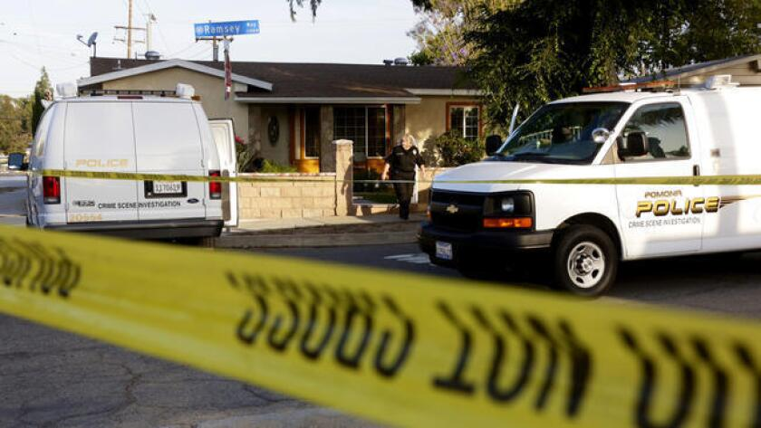Police tape surrounds the scene at a home in the 2100 block of Ramsey Way in Pomona, where four bodies when discovered.