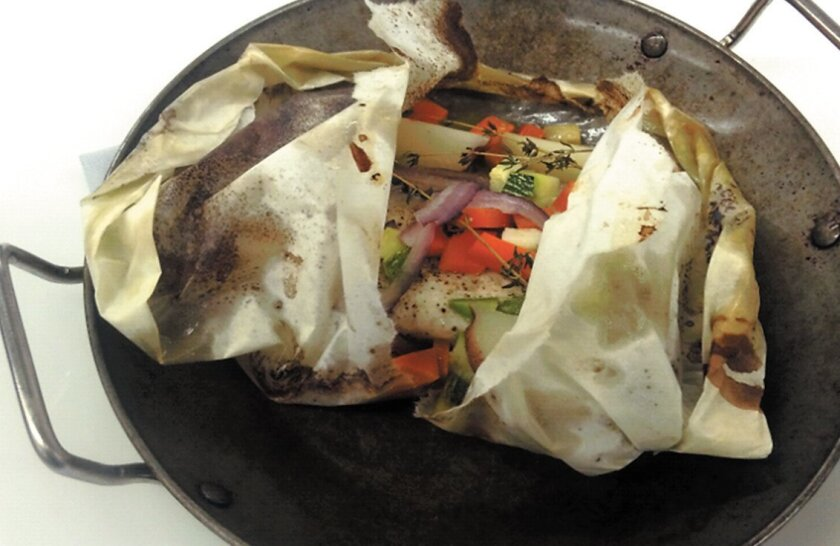 Cooking fish and vegetables in parchment packets creates a moist, fragrant entree.