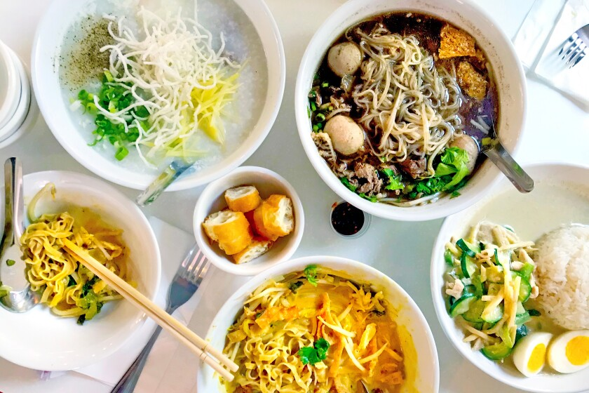 From top left, juk, tom yum soup, khao soi and green curry from Sweet Rice.