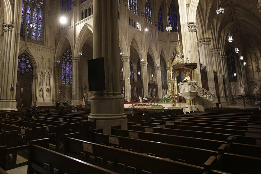 Cardinal Timothy Dolan leads Easter Mass at an empty St. Patrick's Cathedral in New York.