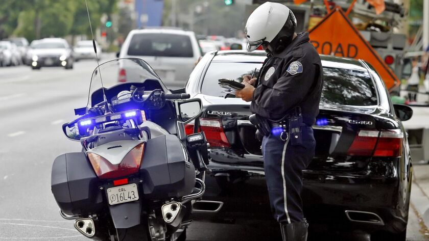 Glendale Police officer Ed Malouf stops a motorist for using a cell phone while driving on Glendale