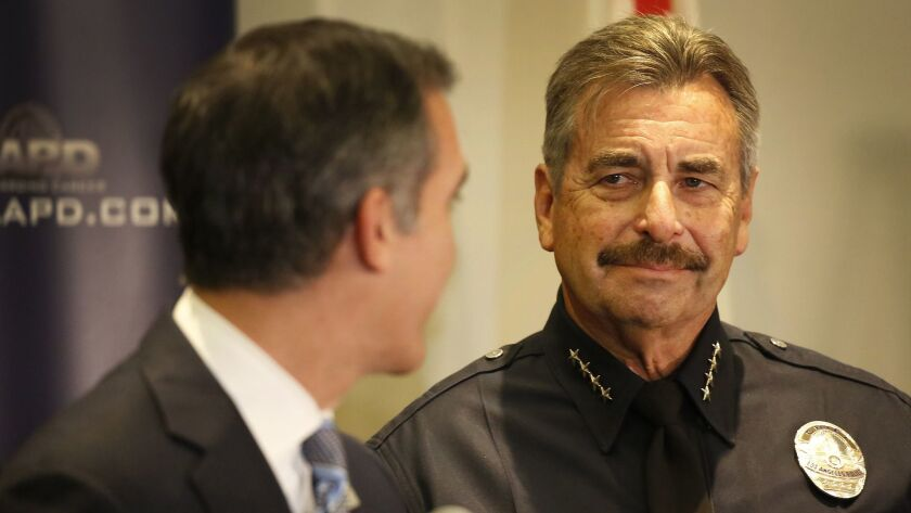 Mayor Eric Garcetti, left, looks at LAPD Chief Charlie Beck after Beck's surprise retirement announcement in January. Beck, who became L.A.'s police chief in 2009, will retire in June.