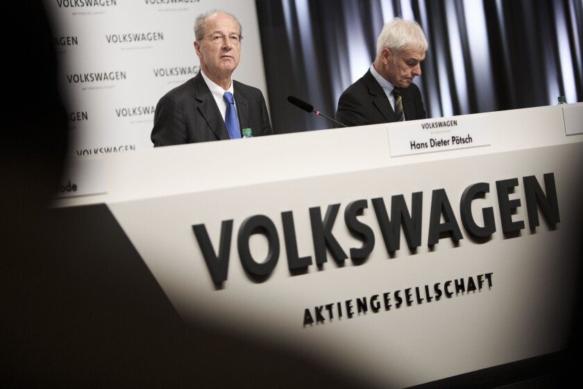 Hans Dieter Poetsch, left, chairman of the Supervisory Board of Volkswagen AG, and Volkswagen Group Chairman Matthias Mueller give an update on the VW emissions scandal.