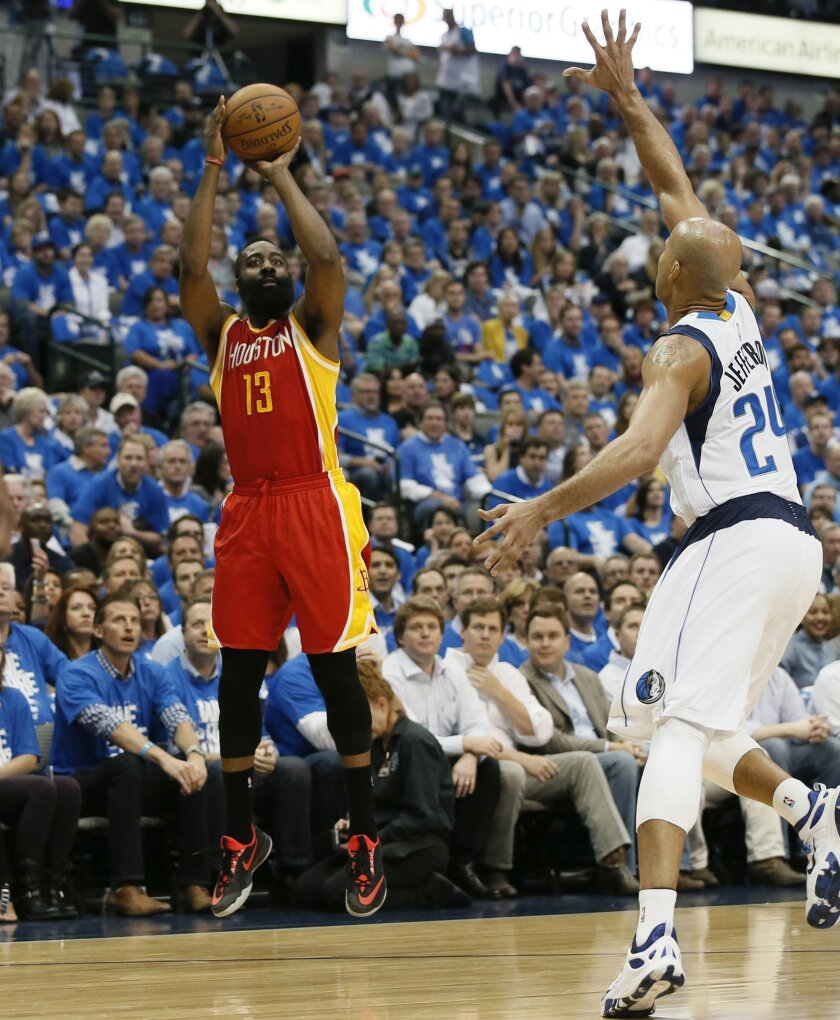 Houston Rockets' James Harden (13) shoots over Dallas Mavericks' Richard Jefferson (24) during the first half of Game 3 in an NBA basketball first-round playoff series Friday, April 24, 2015, in Dallas. (AP Photo/Tony Gutierrez)
