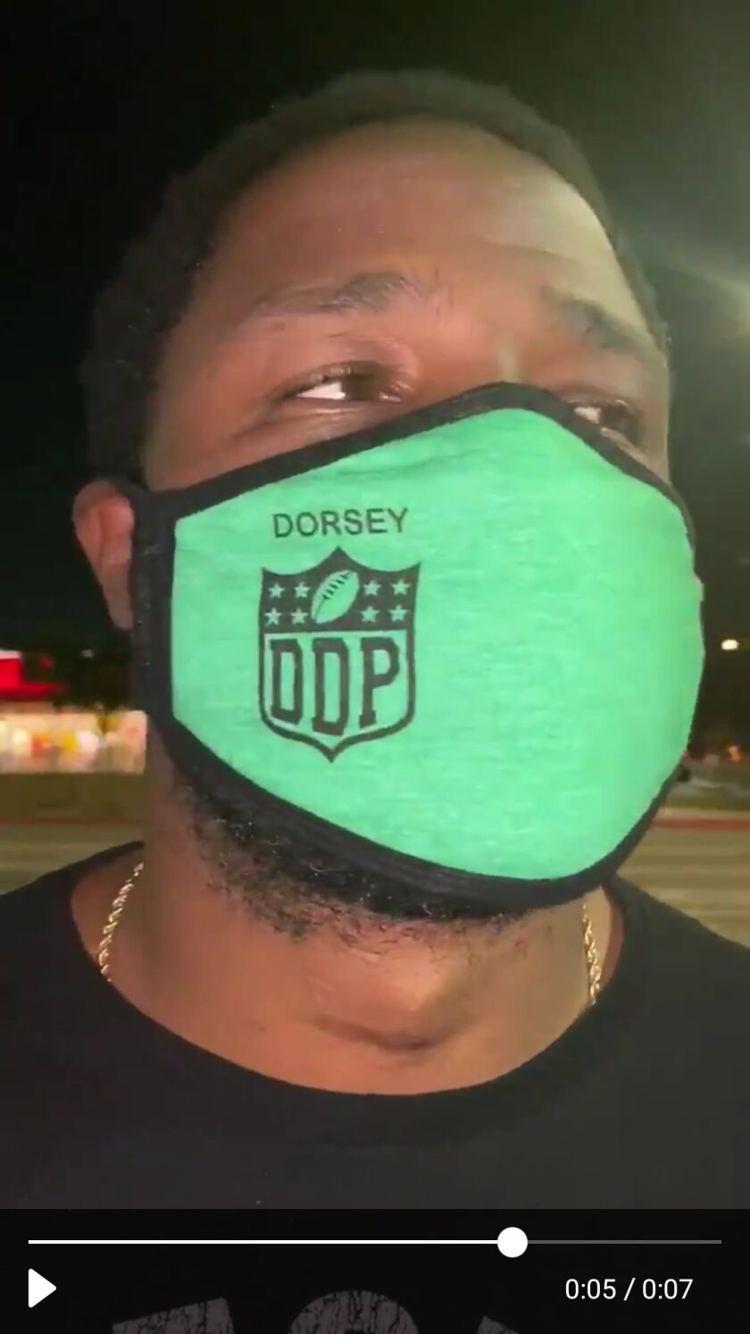 Coach Stafon Johnson models the Dorsey Dons mask