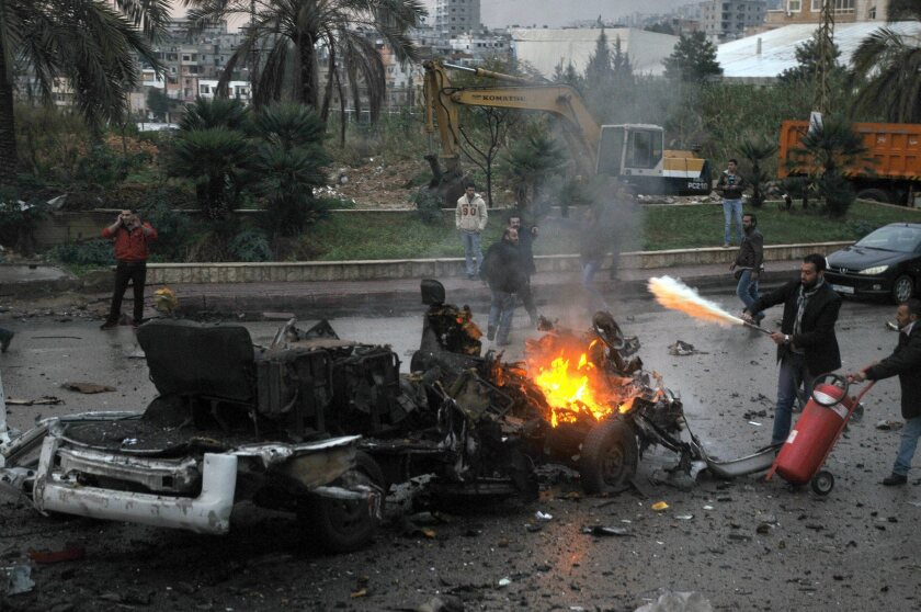 A fire is extinguished at the scene of a suicide bombing in Choueifat, south of Beirut.