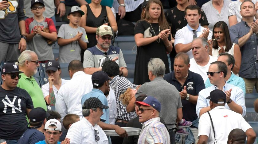 Fans reacts as a young girl is carried out of the stands after being hit by a foul ball during a game between the New York Yankees and Minnesota Twins on Sept. 20 in New York.