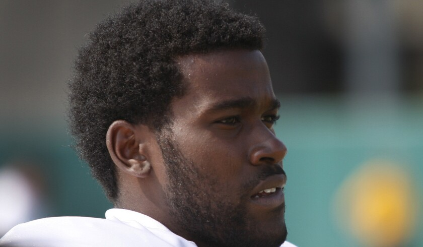 USC linebacker Lamar Dawson watches from the sidelines during practice on Aug. 17, 2012.