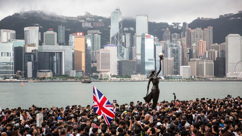Anti-extradition bill protesters take part in a march in Hong Kong, China - 07 Jul 2019