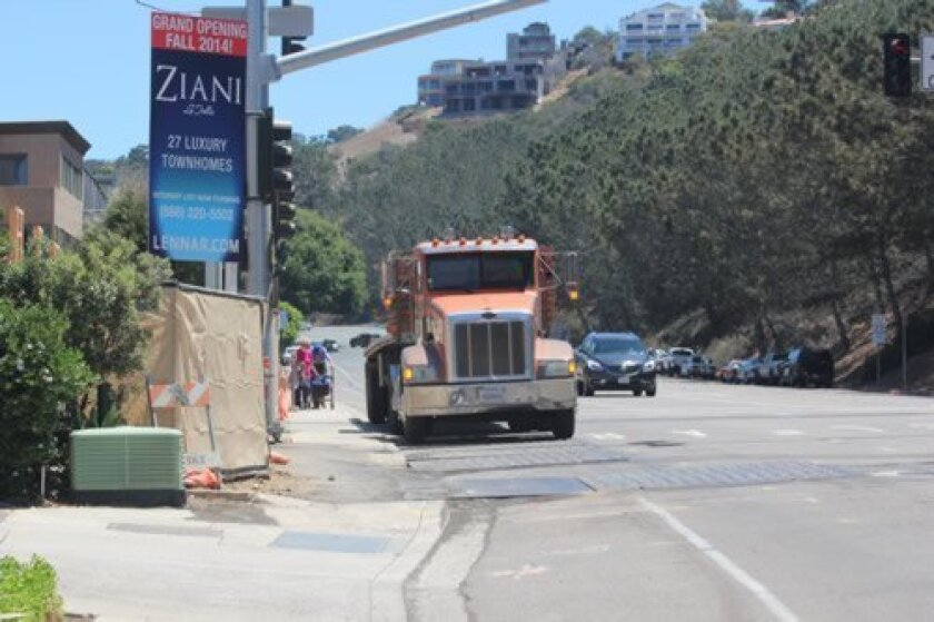 Residents say workers with Lennar's Ziani project at 2402 Torrey Pines Road are parking on the sidewalk and in the bike lane on weekends. Residents also have concerns about construction noise and project density.  Pat Sherman