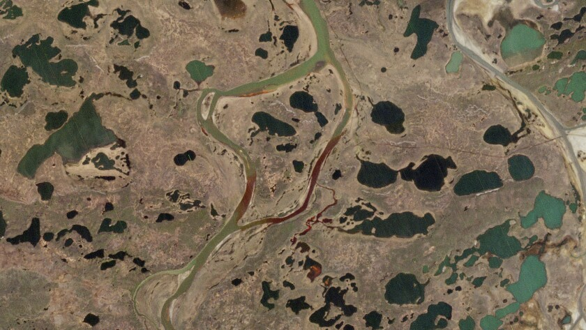This handout photo released by European Space Agency captured on Saturday, May 31, 2020 by the Copernicus Sentinel-2 mission shows the extent of the oil spill, in red, near a power plant in the Siberian city of Norilsk, 2,900 kilometers (1,800 miles) northeast of Moscow, Russia. Russian President Vladimir Putin has declared a state of emergency in a region of Siberia after an estimated 20,000 tons of diesel fuel spilled from a power plant storage facility and fouled waterways. (European Space Agency via AP)
