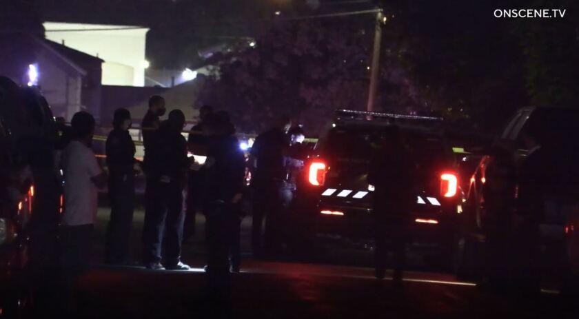 San Diego police gather in street